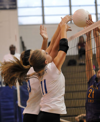 Hannah Rice and Alyssa Anderson play at the net. (Photo by Kevin Nagle)