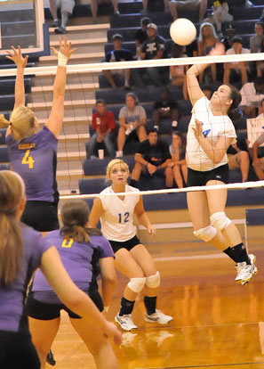 Brooke Howell goes up for a kill in front of teammate McKenzie Rice (12). (Photo by Kevin Nagle)