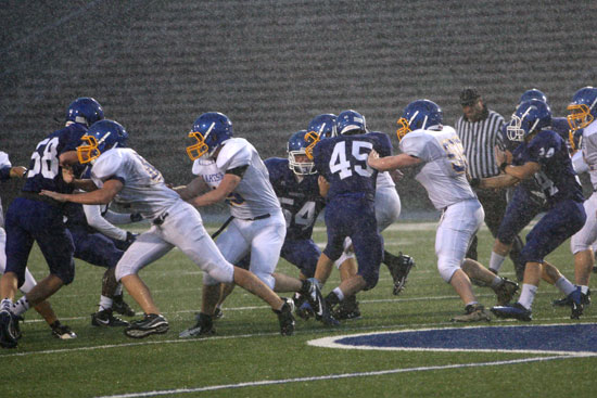 The Hornets and Rams scuffle during Thursday's downpour. (Photo by Rick Nation)