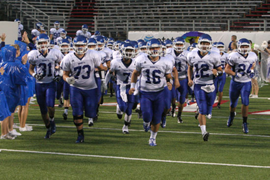 The Hornets take the field. (Photo by Rick Nation)
