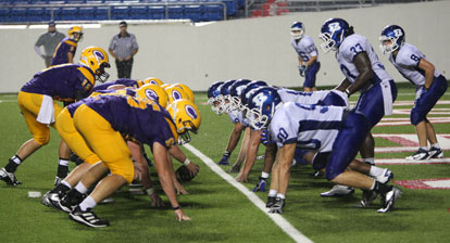 The Bryant defense sets up to keep Catholic out of the end zone. (Photo by Rick Nation)