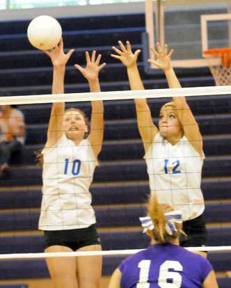 Alyssa Anderson (10) and McKenzie Rice (12) go up for a block. (Photo by Kevin Nagle)