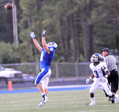 Davis Nossaman (8) leaps up for his interception. (Photo by Kevin Nagle)