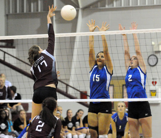 Aubree Allen (15) and Emily Henson (2) go up to try to block an attack. (Photo by Kevin Nagle)