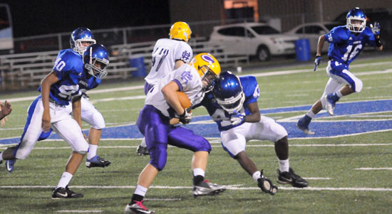 Khaliq Slater (43) makes a tackle as teammates Kameron Guilory (40) and Nick Hardin (16) pursue. (Photo by Kevin Nagle)