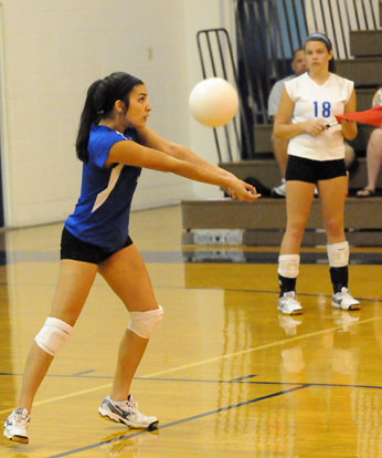 Rochelle Aguilar receives a serve. (Photo by Kevin Nagle)