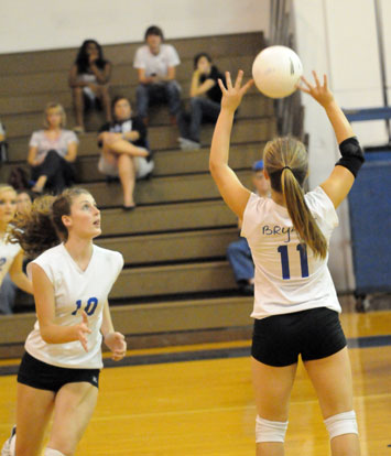 Hannah Rice (11) sets for Alyssa Anderson (10)