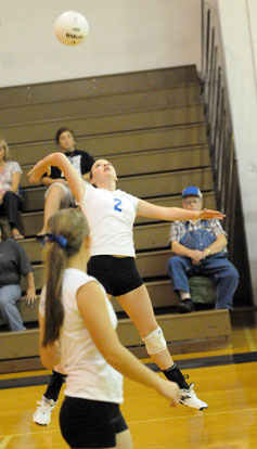 Emily Henson (2) prepares to take a swat at the ball. (Photo by Kevin Nagle)
