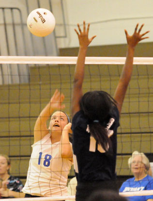 Rylee Phillips (18) sends an attack over the net. (Photo by Kevin Nagle)