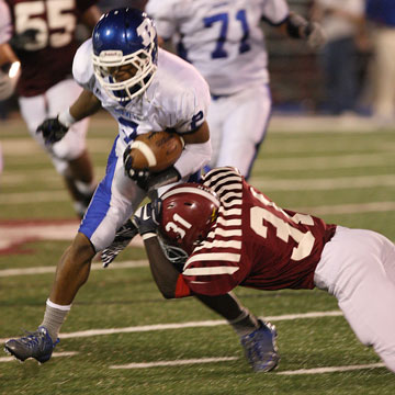 Brushawn Hunter tries to get through a tackle by Pine Bluff's Roderick O'Bryant. (Photo by Rick Nation)