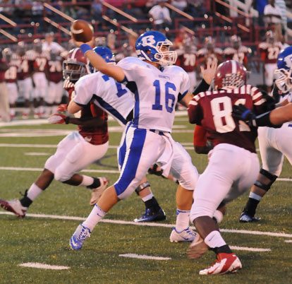 Hayden Lessenberry steps into a throw as Pine Bluff's Cameron Jackson (81) applies pressure. (Photo by Kevin Nagle)