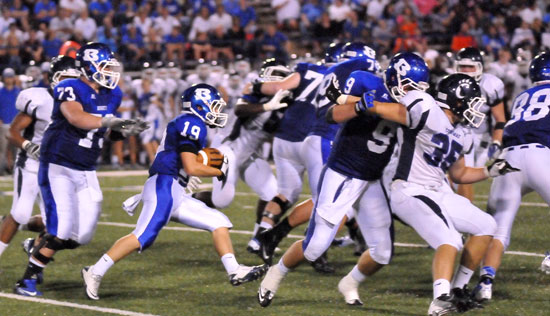 Jacob Irby (19) cuts upfield behind blocking from Blake Hobby (73), Wesley Akers (9), Nate Rutherford (88) and others. (Photo by Kevin Nagle)