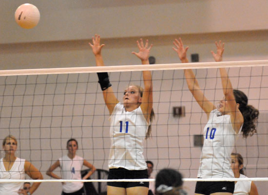 McKenzie Rice (12) and Alyssa Anderson (10) got up to block a Texarkana hit. (Photo by Kevin Nagle)