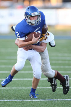 Jake East tries to break a tackle. (Photo by Rick Nation)