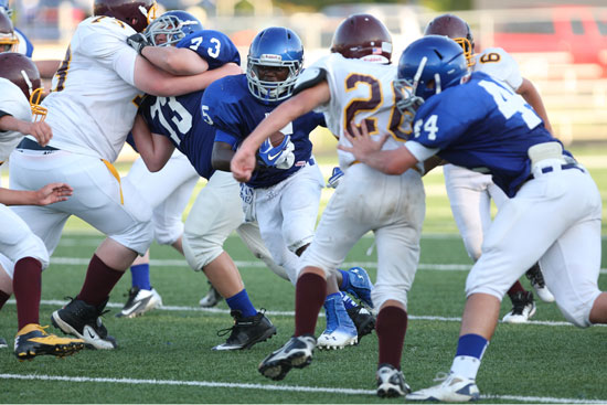 De'Amonte Terry cuts upfield off blocks by Noah Easterling (73) and Hayden Knowles (44). (Photo by Rick Nation)