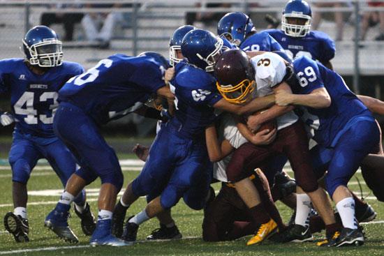 Bryant's Austin Blacklaw (69), Devin Howard (45), Nick Harden (16) and Jacob Hall (58) bring down Lake Hamilton quarterback Dallas Baldwin (3) as Khaliq Slater (43) comes up to help. (Photo by Rick Nation)