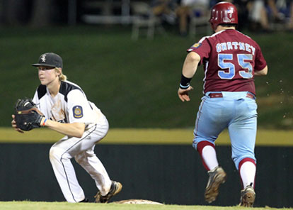 Dalton Holt takes a throw at first to compete a fourth-inning doubleplay. (Photo by Rick Nation)