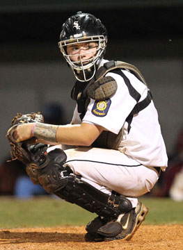 Catcher Bailey Bowers looks into the dugout for a sign. (Photo by Rick Nation)