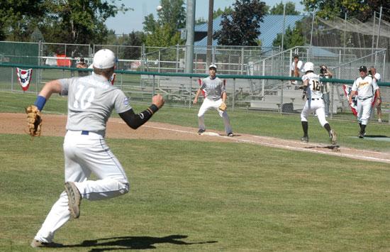 Bryant third baseman Garrett Misenheimer makes throw to first baseman Aaron Orender to retire Jasper base runner is Jared Sermersheim. (Photo by Steven Smith/Hometown Sports)