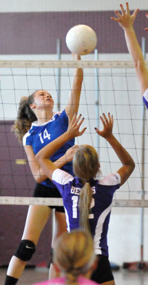 Sierra Jones (14) goes high for a spike. (Photo by Kevin Nagle)