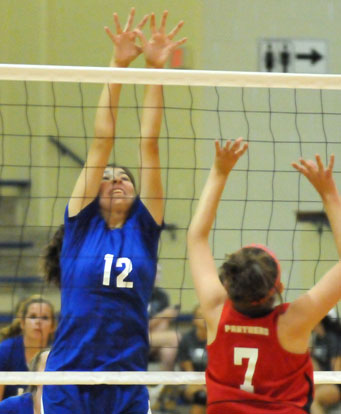 Erin Chappell (12) tries to block a Cabot North hit during Bryant White's match Monday night. (Photo by Kevin Nagle)