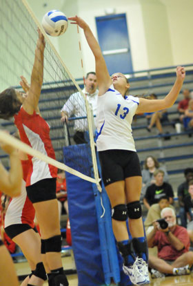 Sarah Kennedy (13) tips the ball at the net. (Photo by Kevin Nagle)
