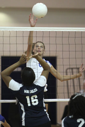 Allie Anderson (6) pounds one of her team-high six kills. (Photo by Rick Nation)