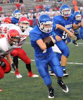 Bryant quarterback Beaux Bonvillain scrambles. (Photo by Kevin Nagle)