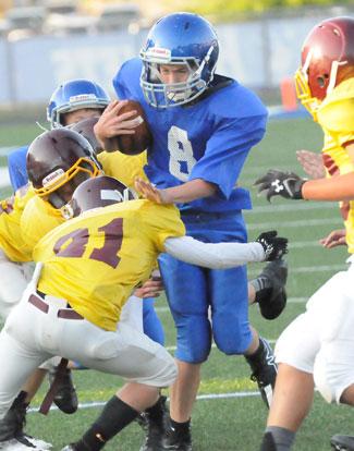 Cody Conrad (8) tries to avoid a Lake Hamilton tackler. (Photo by Kevin Nagle)