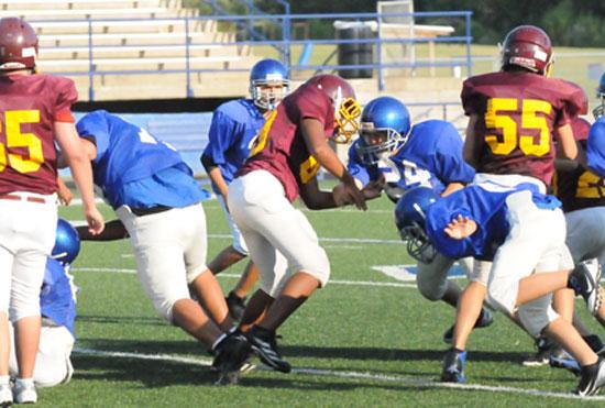 Tyler Jordan (24) takes on a blocker as the Hornets scramble on defense. (Photo by Kevin Nagle)