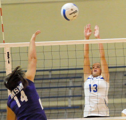 Bryant's Sarah Kennedy (13) goes for a block. (Photo by Kevin Nagle)