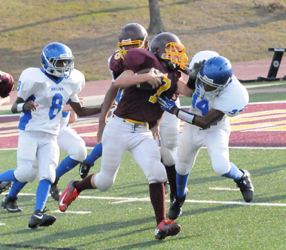 Keshaun Davis (34) grabs Lake Hamilton's Dagen Stacks (7) as help arrives from James Polite. (Photo by Kevin Nagle)