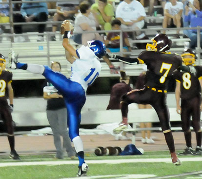 Austin Kelly (10) leaps for an interception in front of Lake Hamilton's Jacob Graves. (PHoto by Kevin Nagle)