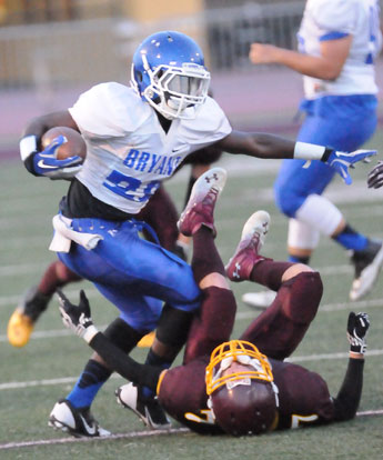 Bryant's Phillip Isom-Green runs over a Lake Hamilton defender. (Photo by Kevin Nagle)