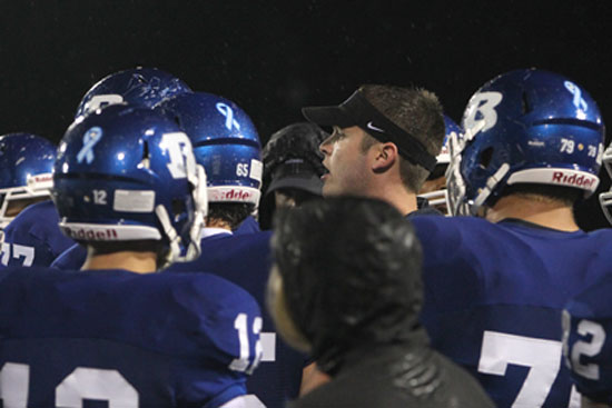 Bryant offensive coordinator Lance Parker instructs the Hornets during a timeout. (Photo by Rick Nation)