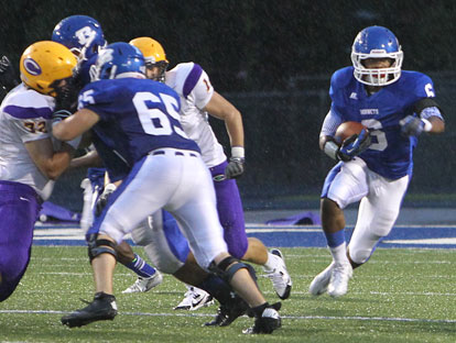 Jacob Ward (65) helps clear the way for Brendan Young (6). (Photo by Rick Nation)