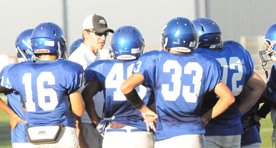Bryant White head coach Brad Smothermon instructs his players during a timeout. (Photo by Kevin Nagle)