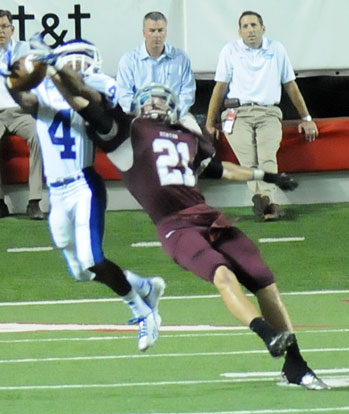 Bryant's Mark Nelson (4) intercepts over Benton's Sam Baker (21). (Photo by Kevin Nagle)