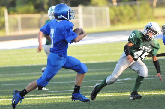 Tyler O'Neal (3) looks for room to get around Pulaski Heights' Kaleb Farrell (45). (Photo by Kevin Nagle)