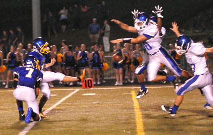Bryant players crash in to block an extra point attempt. (Photo by Kevin Nagle)