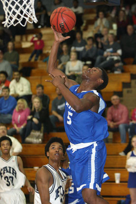 K.J. Hill overcame early foul trouble to score 18 points to lead the Hornets. (Photo by Rick Nation)