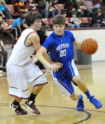Bryant's Evan Lee tries to drive around a Benton defender. (Photo by Kevin Nagle)
