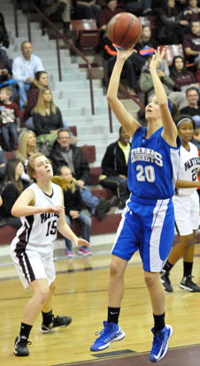 Kailey Nagle (20) shoots a short jumper in front of Benton's Abby Clay. (Photo by Kevin Nagle)