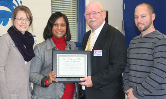 From left: Pam Kenney, Bryant Schools Director of Professional Development; Davis Elementary School Principal Tiffany Beasley; Shannon Hill Mayor Mike Kemp; and Jeff Reed, Parks Committee Chairman.