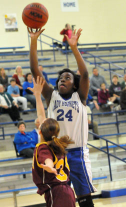Penny Smith (24) goes up for a shot inside. (Photo by Kevin Nagle)