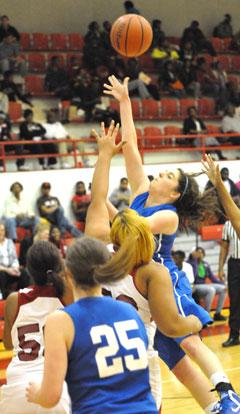 Courtney Davidson powers up a shot inside. (Photo by Kevin Nagle)