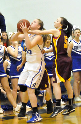 Haley Murphy (45) is fouled on the way up for a shot by Lake Hamilton's Kelli Suta. (Photo by Kevin Nagle)