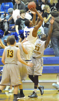 Brian Reed (35) shoots over Lake Hamilton's Malik Blevins (33). (Photo by Kevin Nagle)