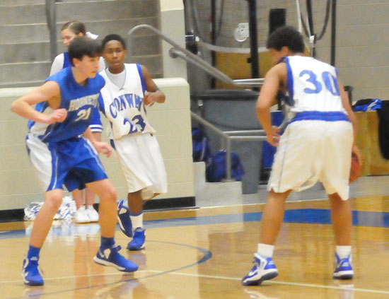 Hunter Handly, left, guards against a Conway White ballhandler. (Photo by Kevin Nagle)