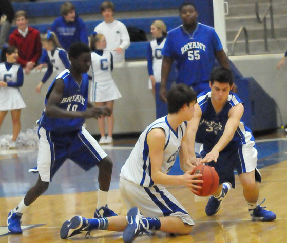 Bryant's Clay ingold tried to tie up a Conway White player as Kevin Hunt (10) comes in to help. (Photo by Kevin Nagle)